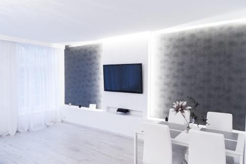 Telewizja i/lub zestaw kina domowego w obiekcie Apartament na Starówce Ogarna