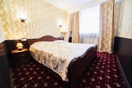 Кровать или кровати в номере Гостевой дом Пан Турист