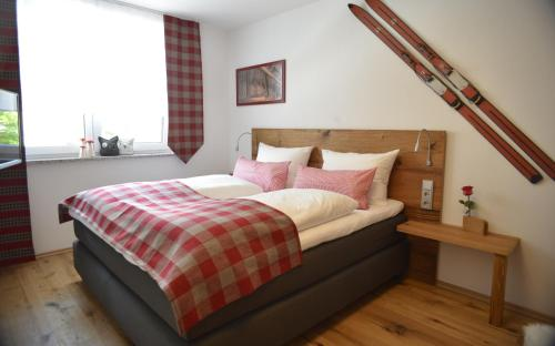 A bed or beds in a room at Chalet Gretl