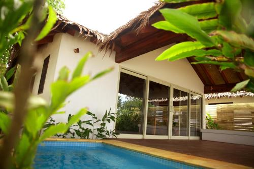 The swimming pool at or near Vale Vale Beachfront Villas