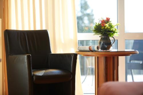 Ein Sitzbereich in der Unterkunft Hotel Landhaus Berghof