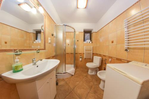 Łazienka w obiekcie Domek Marców