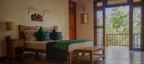 A bed or beds in a room at Jim's Farm Villas