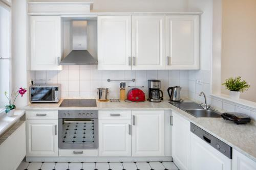 A kitchen or kitchenette at Charles Bridge Premium Apartments
