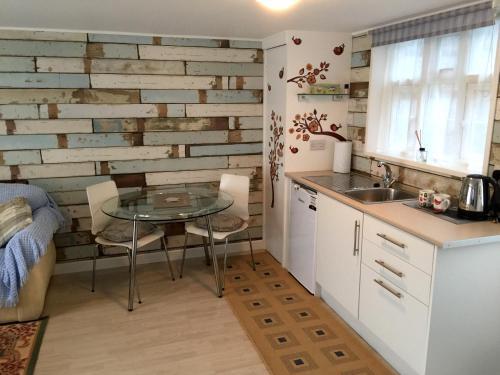 A kitchen or kitchenette at Lark Rise B&B