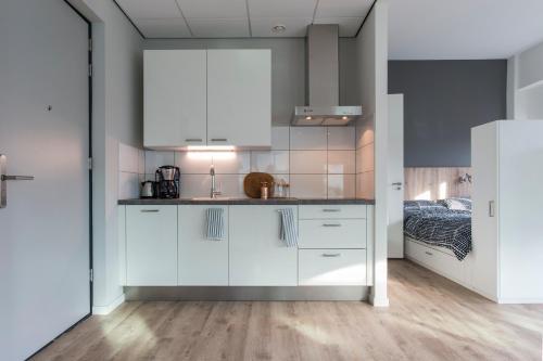 A kitchen or kitchenette at JOINN! City Lofts Houten Utrecht