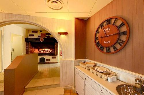 A kitchen or kitchenette at Le Tournedos