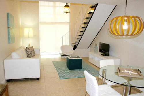 A seating area at Ocean Vacation Homes