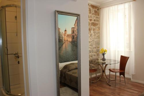 A bed or beds in a room at City Break Dubrovnik Apartments