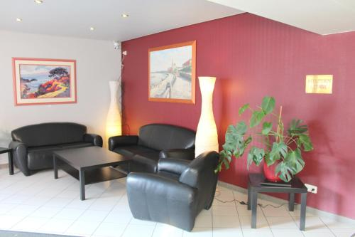 A seating area at Hotel Elbroich
