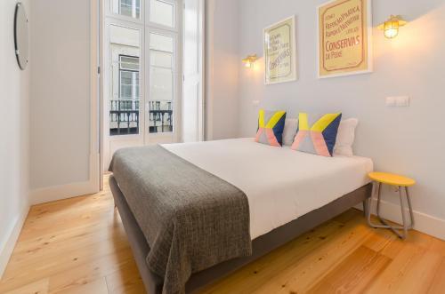 Uma cama ou camas num quarto em Casas da Baixa - Lighthouse Apartments