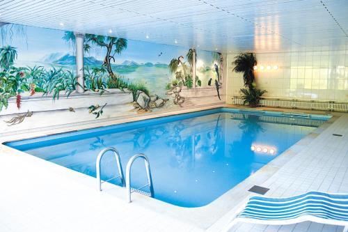 The swimming pool at or near Hotel Schützenhof