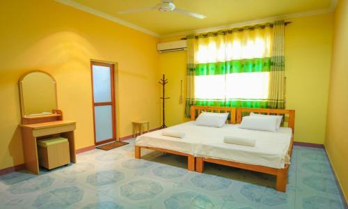 Ein Bett oder Betten in einem Zimmer der Unterkunft Jail Break Surf Inn