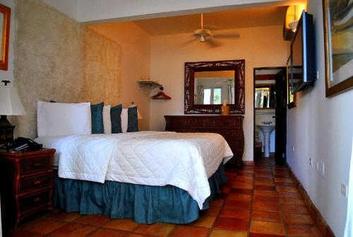 A bed or beds in a room at Acacia Boutique Hotel