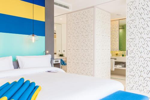 A bed or beds in a room at Sofitel Tamuda Bay Beach And Spa