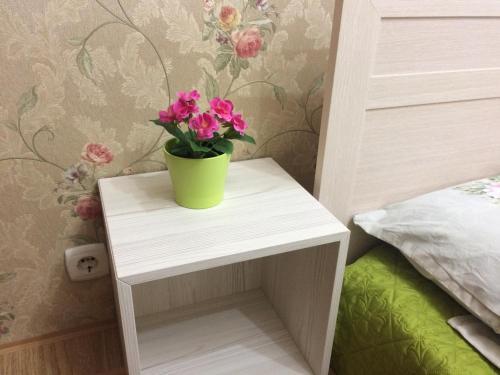 Кровать или кровати в номере Apartments on Ostrovskogo 1