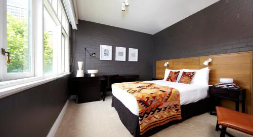 A bed or beds in a room at Harbour Rocks Hotel Sydney – MGallery by Sofitel