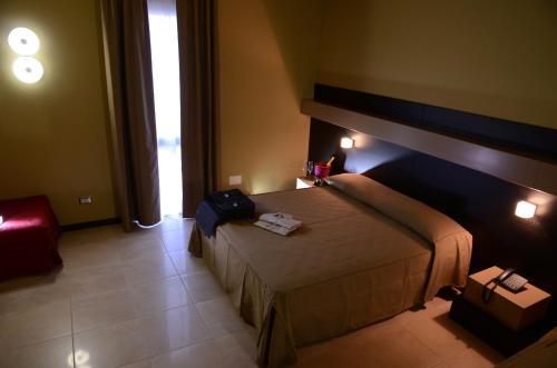 Letto o letti in una camera di Melqart Hotel