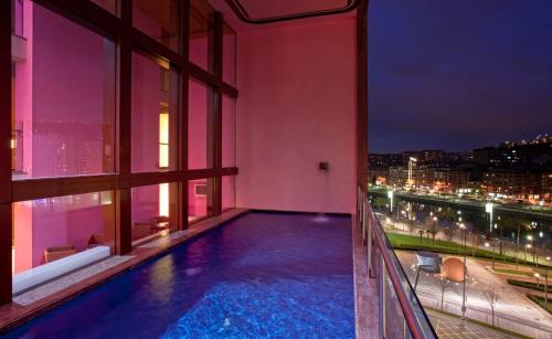 The swimming pool at or close to Hotel Meliá Bilbao