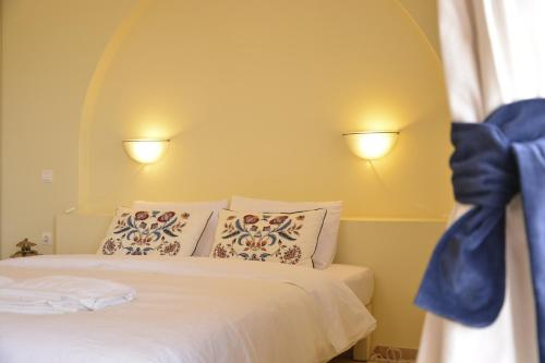 A bed or beds in a room at Olive Coast Suites
