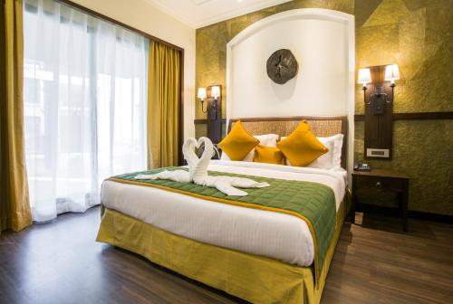 A bed or beds in a room at Rhythm Lonavala - An All Suite Resort