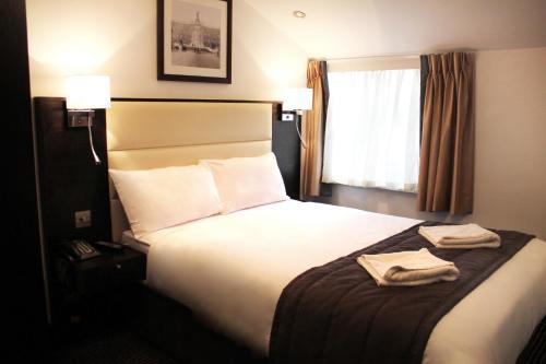 Un ou plusieurs lits dans un hébergement de l'établissement Hotel Edward Paddington