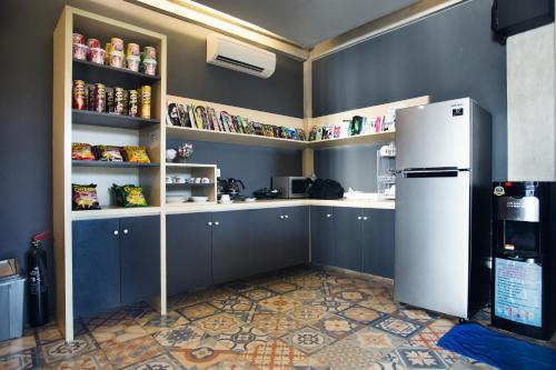 A kitchen or kitchenette at M Boutique Hostel