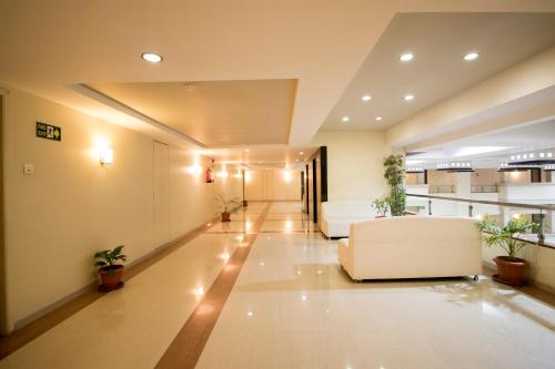 The lobby or reception area at Hotel Grand International