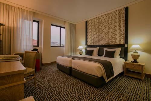 Cama o camas de una habitación en Hotel Mundial