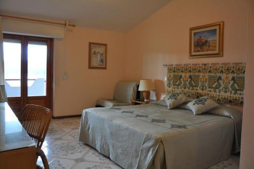 Cama o camas de una habitación en Hotel L'Oasi
