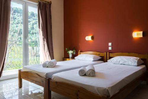 A bed or beds in a room at Act Art Skiathos