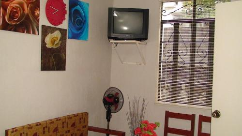 A television and/or entertainment center at Lyn's Do Drop Inn Transient House
