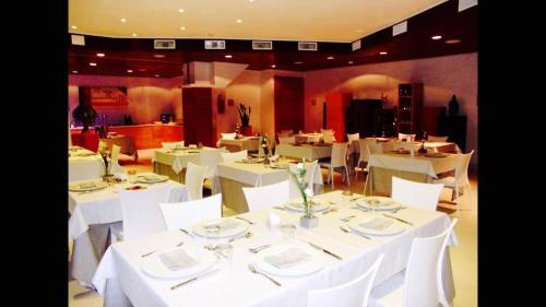 A restaurant or other place to eat at Hotel Zodiaco