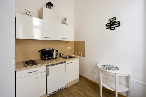 A kitchen or kitchenette at Monello Apartments