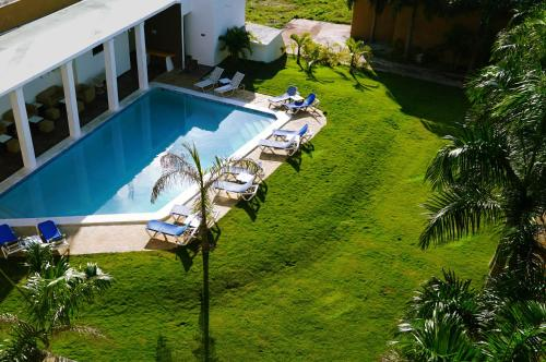 A view of the pool at Hotel Marimba Punta Cana or nearby