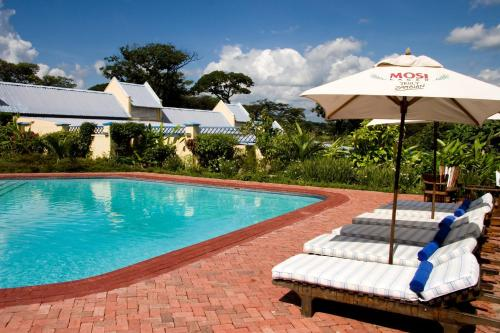The swimming pool at or near Protea Hotel by Marriott Chingola
