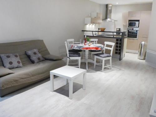 A seating area at Apartment Les Cerfs