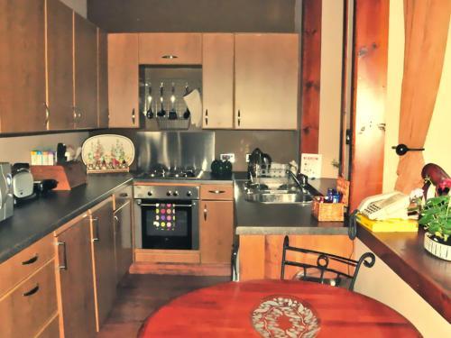 A kitchen or kitchenette at Apartment Auchenblae