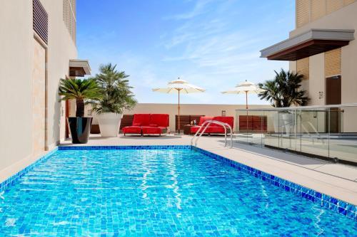 The swimming pool at or near Centro Capital Doha - By Rotana