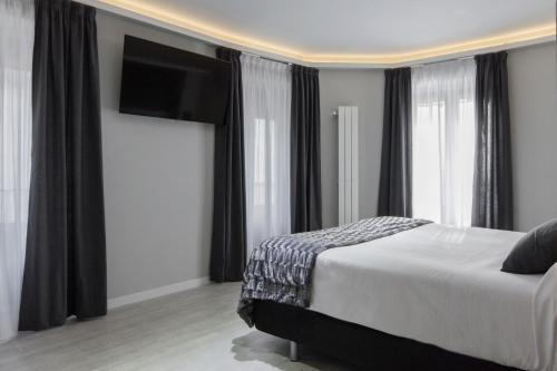 Cama o camas de una habitación en Hostal Overnight Madrid