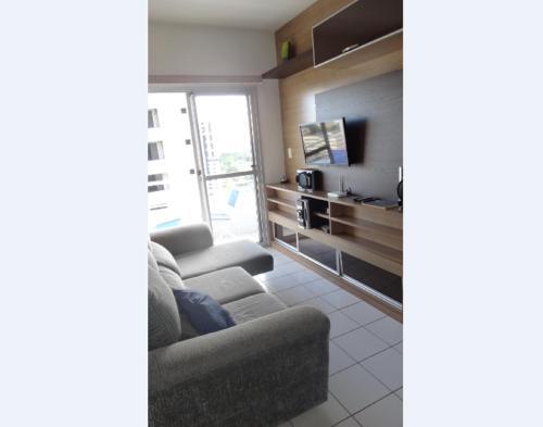 Zona de estar de Ajuricaba Suites 6