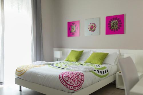 A bed or beds in a room at Frammenti