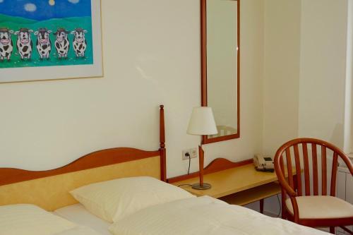 Un ou plusieurs lits dans un hébergement de l'établissement Hotel Prins Maurits