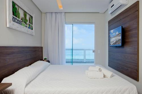 Cama ou camas em um quarto em Pousada Gaúcha