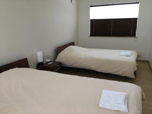 A bed or beds in a room at Ume