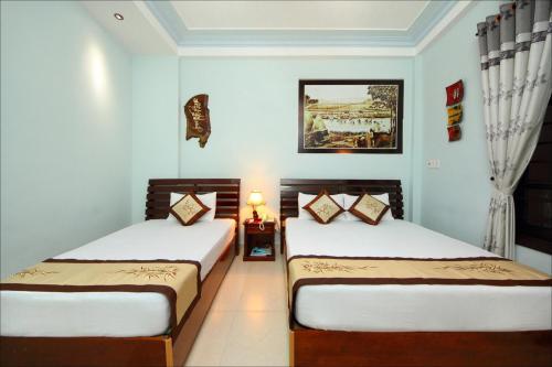 Ein Bett oder Betten in einem Zimmer der Unterkunft Dong Nguyen Riverside Homestay