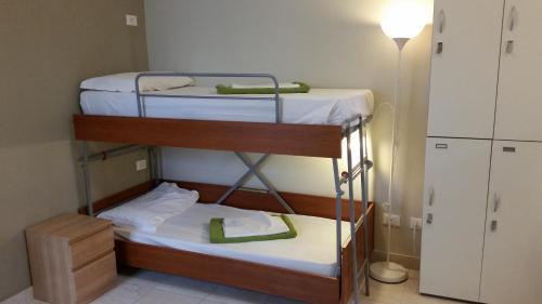 Ein Etagenbett oder Etagenbetten in einem Zimmer der Unterkunft Hostel Mosaic