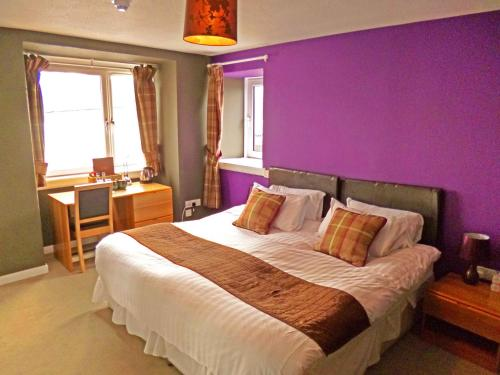 A bed or beds in a room at Argyll Hotel