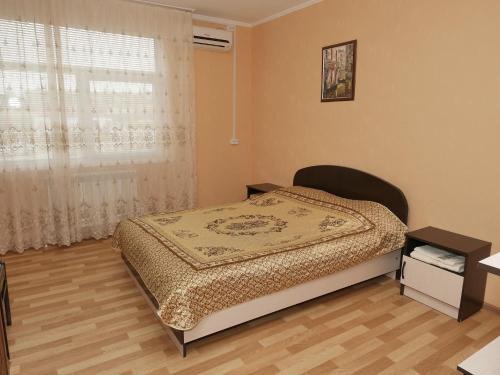 Кровать или кровати в номере Мини Отель Альфа