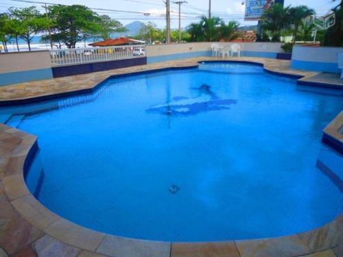 A piscina localizada em Apartamento de Frente para o Mar ou nos arredores